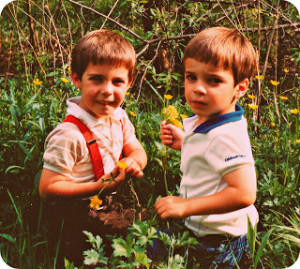 Timmy and Benji Slabach help gather flowers