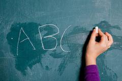 wiriting-letters-chalkboard-28547172