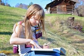 child readingn outside
