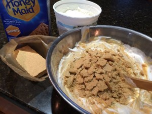 pudding with crackers on top being mixed