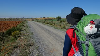 pilgrim man with backpack