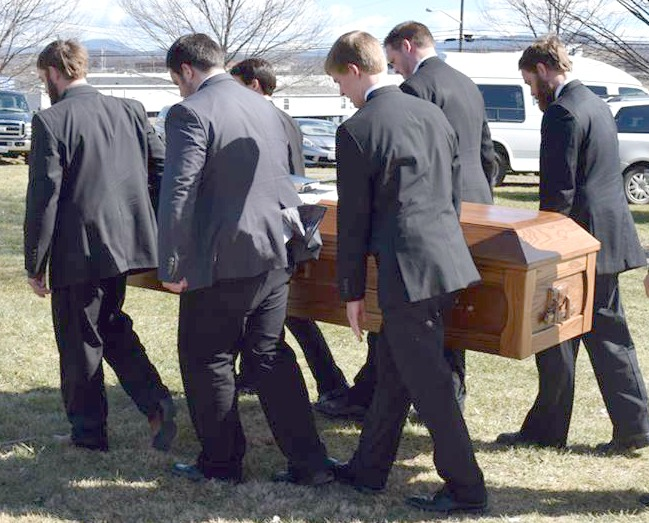grave grandsons carrying casket 2