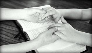 prayer holding hands